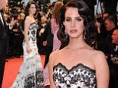 cannes film festival 2013: lana del rey fits in with the cannes opening ceremony theme as she dresses in the great gatsby-style vintage frock and hair